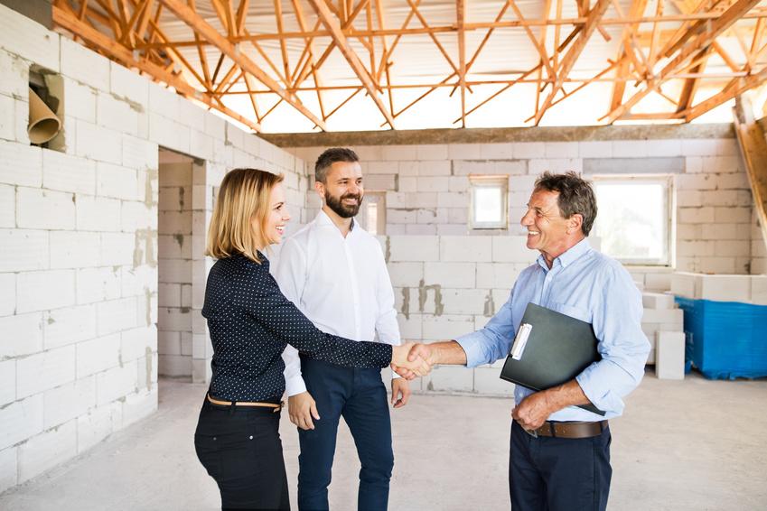 Handshake amid construction