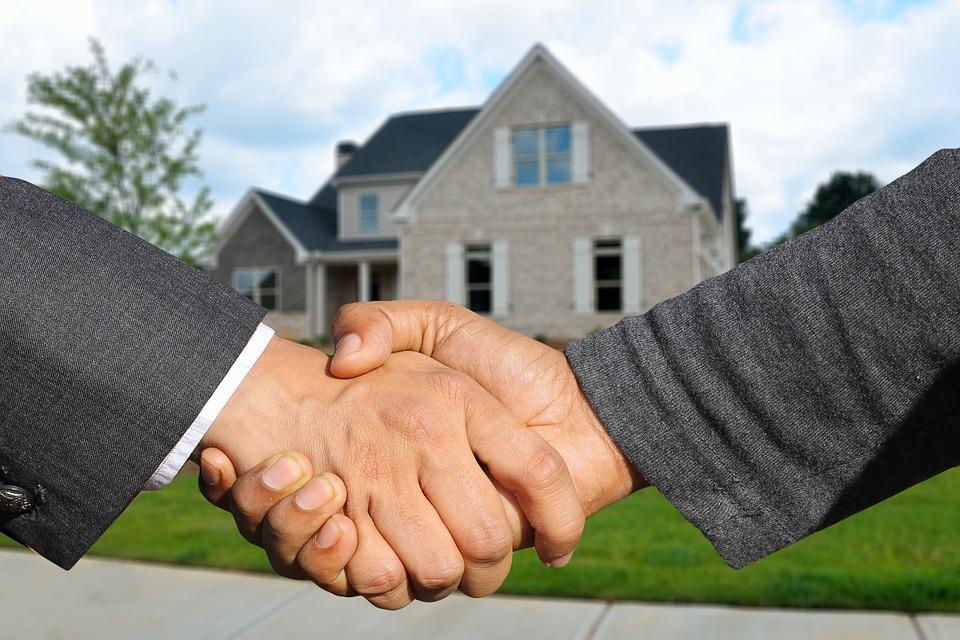 Handshake in front of home